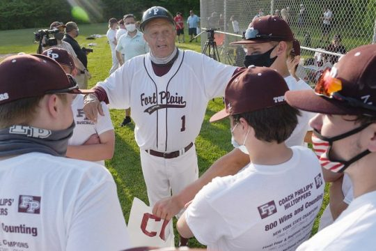 Fort Plain baseball coach Craig Phillips gathers with his team after they beat Mayfield for the 800th win of his career midway through the spring season.
