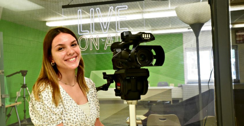 Mohonasen senior Caitlyn Breen stands with a video camera, a major part of her high school career, outside the Mohonasen Media Arts Studio at the high school on Tuesday.