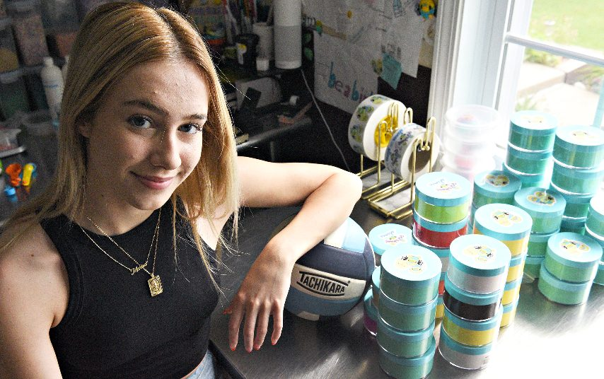 """Schenectady High School senior Marisa Gannon with her """"Parakeet Slimes"""" products at her home."""