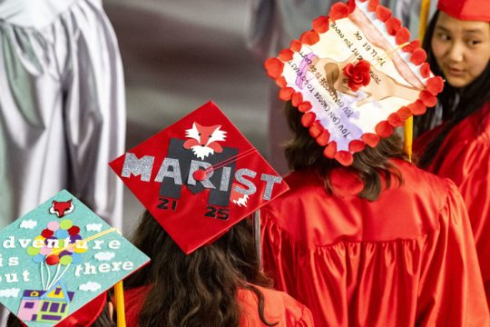 Niskayuna High School seniors Jennifer Liguori, left, her twin sister Emily Liguori, and Holly Lightbody show off their mortarboards prior to  Commencement Exercises at the Times Union Center in Albany Wednesday