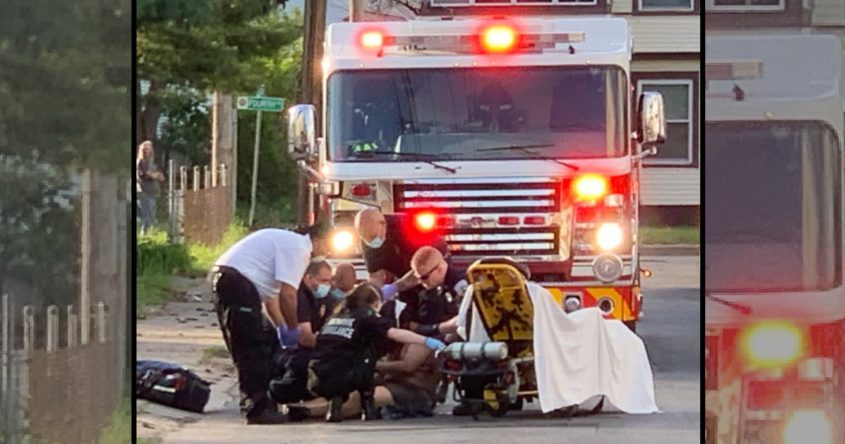 First responders treat the victim May 17 near the corner of Pleasant Street and Fourth Avenue