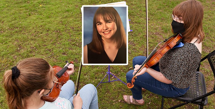Alyeene Zabrowski,a senior at Scotia-Glenville High School, gives an outdoor violin lesson to Maddy, age 9, in her backyard in Scotia last month.