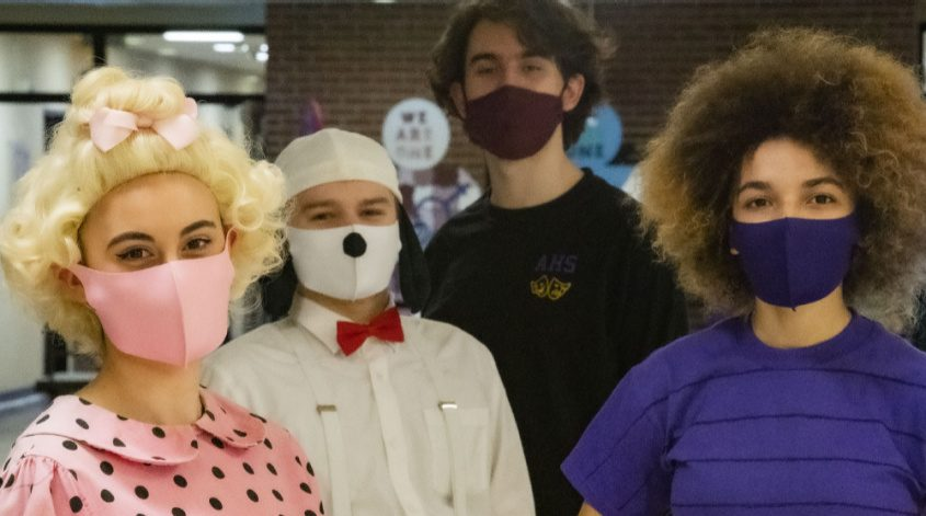 Amsterdam High School seniors Melody Valberg, left, Cameron Goehrig, Lucas Sarabia and Billie Bennett pose on May 14 at the school.