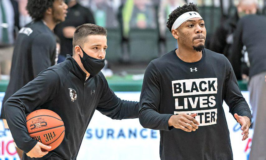 Harley Fuller, left, is shown with Jalen Pickett before a Siena men's basketball game last season. (Photo courtesy Siena athletics)