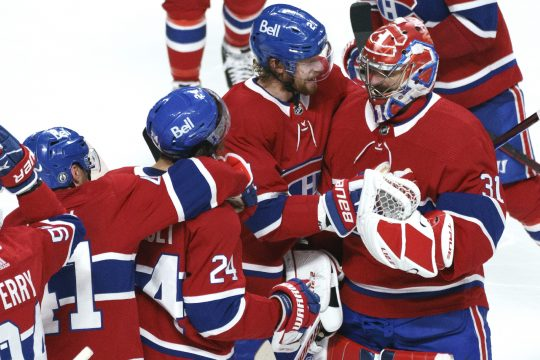 The Montreal Canadiens' Eric Staal (21) celebrates the team's win with goaltender Carey Price following overtime in Game 6 of an NHL Stanley Cup semifinal series against the Vegas Golden Knights on Thursday in Montreal. (Paul Chiasson/The Canadian Press via AP)