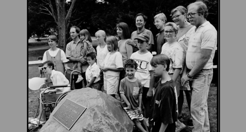 """The family of the late Theodore G. """"Ted"""" Schwarz III gather around a plaque dedicated to Schwarz on July 4, 1991  -- an event that followed the Alplaus parade to mark the holiday."""