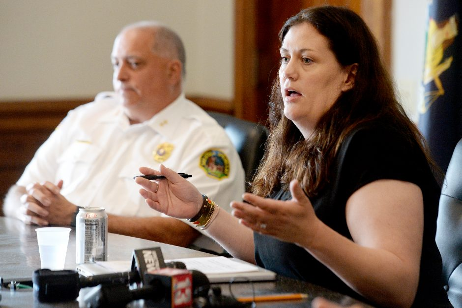 Saratoga Springs Commissioner of Public Safety Robin Dalton,sitting next to Assistant Police Chief John Catone, speaks during a press conference regardingrecentviolence in the city.
