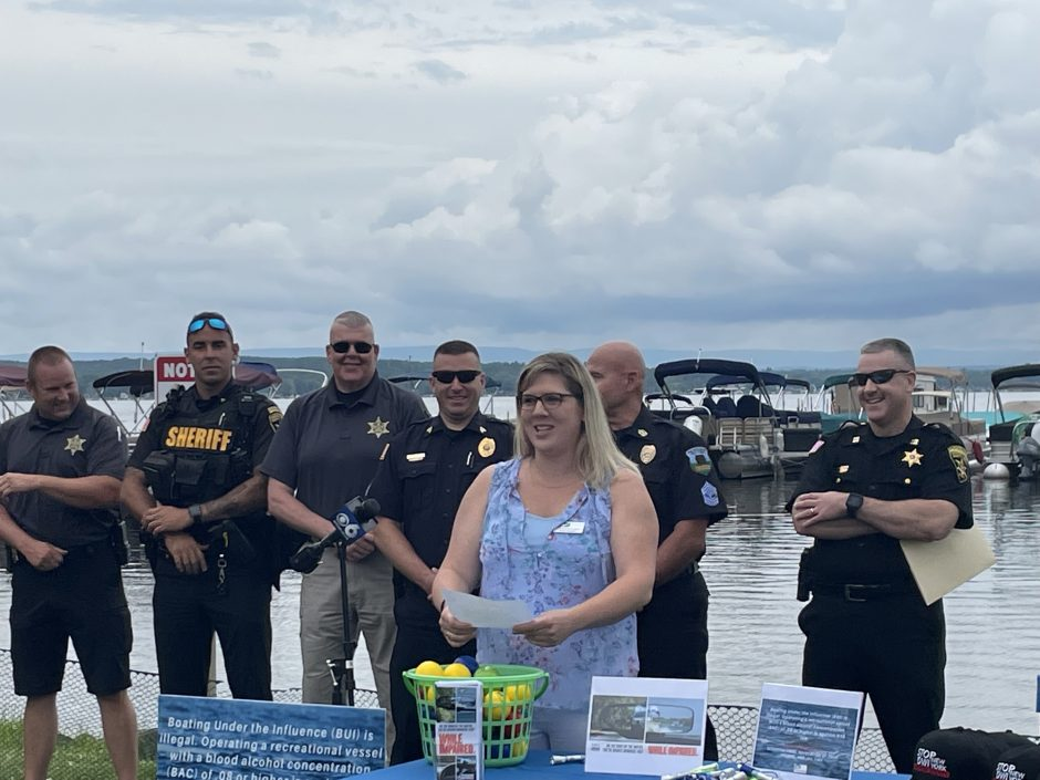 Amber Danaher, outreach coordinator for The Prevention Council of Saratoga County, speaks about boating safety on Thursday at Brown's Beach in Saratoga Springs.