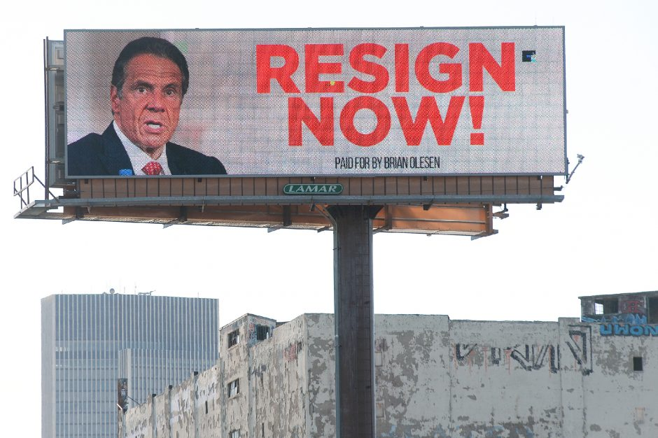 """A """"Resign Now!"""" billboard with Gov. Andrew Cuomo's face on it flashes along I-787, paid for by Brian Olesen, in Albany on March 2."""
