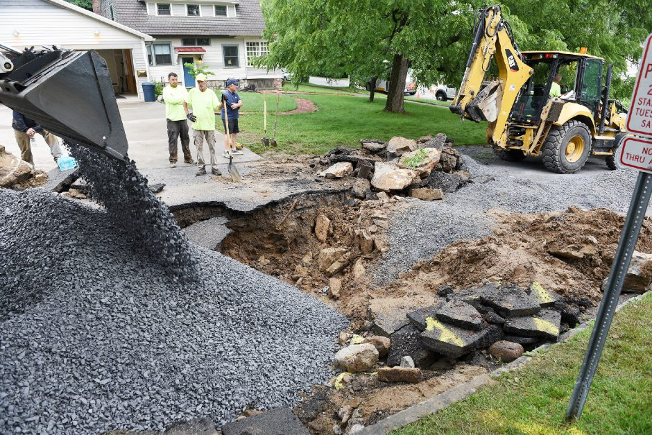 Saratoga Springs water crews on Friday repair a water main break that occurredearlyThursday morning on Green Street.