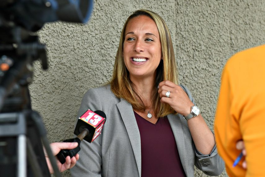 Katie Marcella speaks with the media in front of Alumni Gym as she was introduced as Union College's new women's basketball coach on Friday.