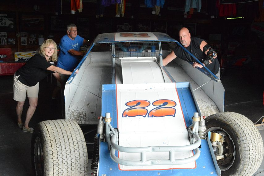 Volunteers Jackie Lape, front left, Dave Delaney, back left, and Shawn Chiuminato move a vintage Dave Lape modified race car at the Fonda Speedway Museum on Friday, July 2.