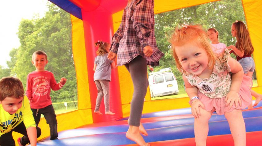 Childrenhop around in the bounce house during the 4th On The 3rd celebration held in Wiles Park in Fort Plain on Saturday.