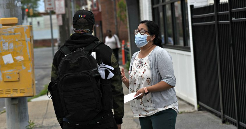 Schenectady County Public Health Nurse Melissa Puicon-Healeytalks to a passerby about COVID vaccination during a June 3 clinic in the Hamilton Hill neighborhood, which has one of the lowest vaccination rates in the county.