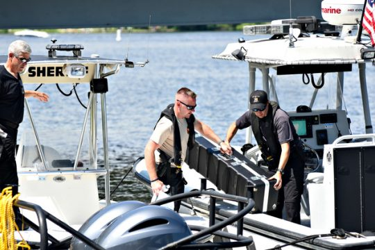 Saratoga County Sheriff deputies load equipment onto one of its safety boats at the Saratoga State Boat Launch at Fish Creek Monday before entering Saratoga Lake after the death of a man in the water there Sunday.