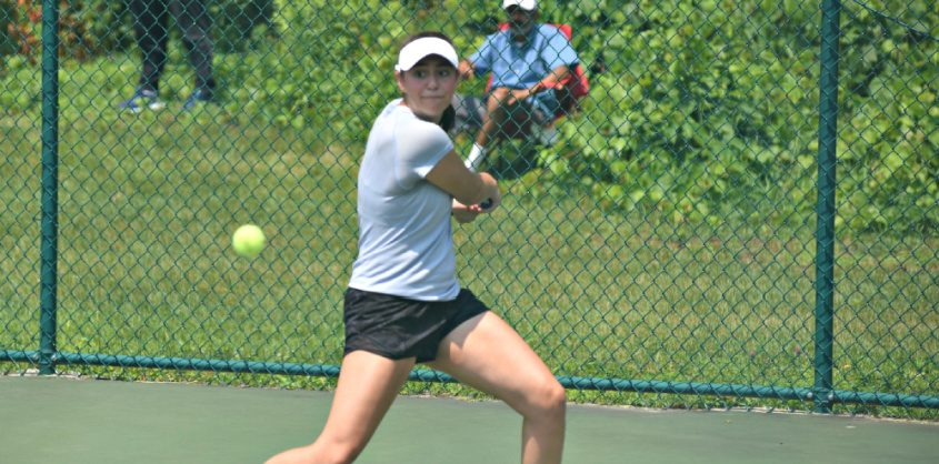 Brooke Hess, a rising senior at the Academy of Holy Angels in New Jersey, returns a serve from Esha Velaga of Colmar, Pennsylvania, during the USTA Level 2 18 & Under national championship qualifier at Schenectady's Central Park tennis courts Monday afternoon.