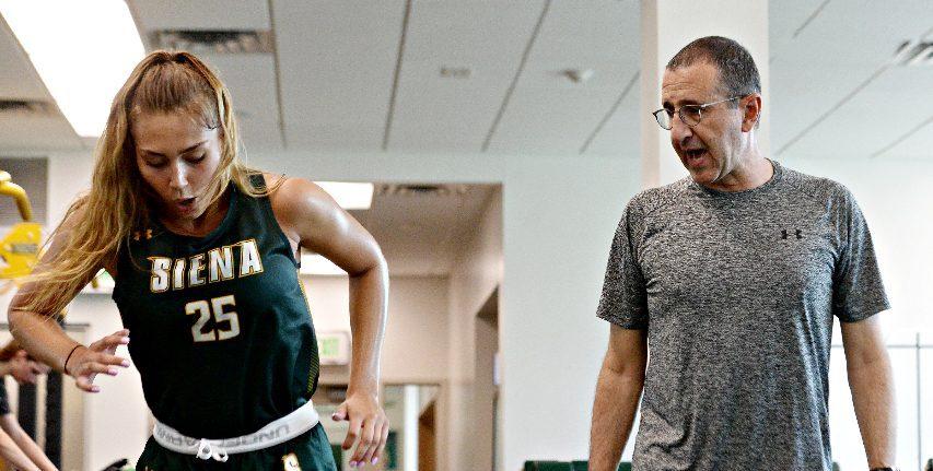 Siena head coach Jim Jabir, right, encourages freshmanEmina Selimovic during Wednesday's workout.