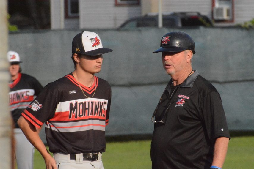 Amsterdam Mohawks pitcher Brendan Disonell, left, talks with head coach Keith Griffin during the first game of a doubleheader against the Glens Falls Dragons on Wednesday, July 7 at East Field in Glens Falls.