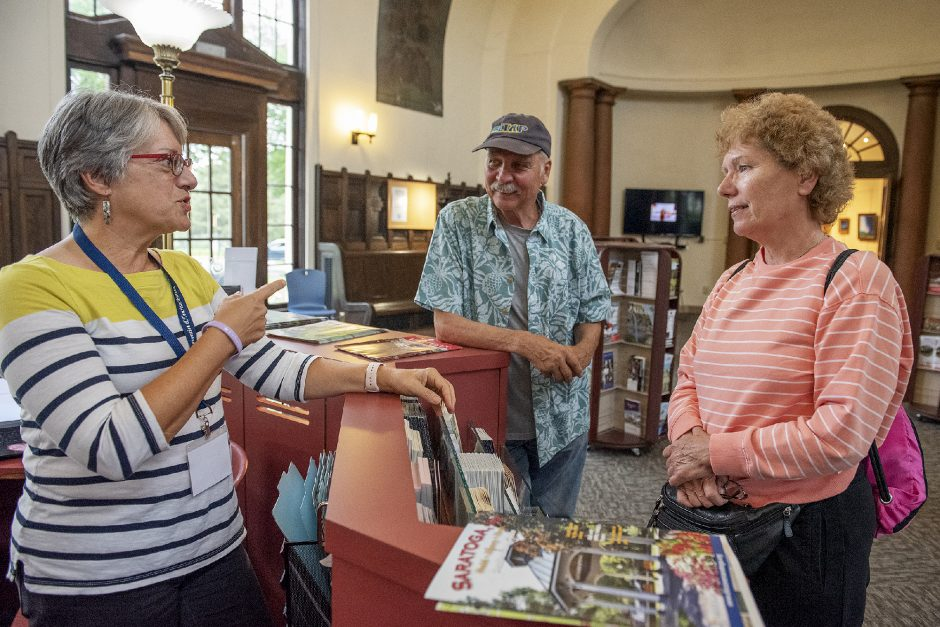 Saratoga Springs Heritage Area Visitor Center volunteer Fran Bruno speaks with visitors Roland and Ulrike Arlt of Leonia, N.J. during their stay in Saratoga Springs on Thursday.