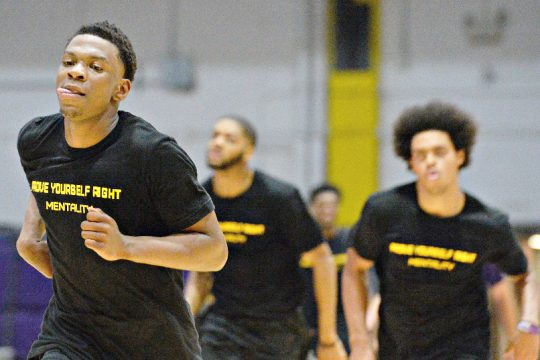 Will Amica, left, is shown sprinting during Tuesday's UAlbany men's basketball workout.