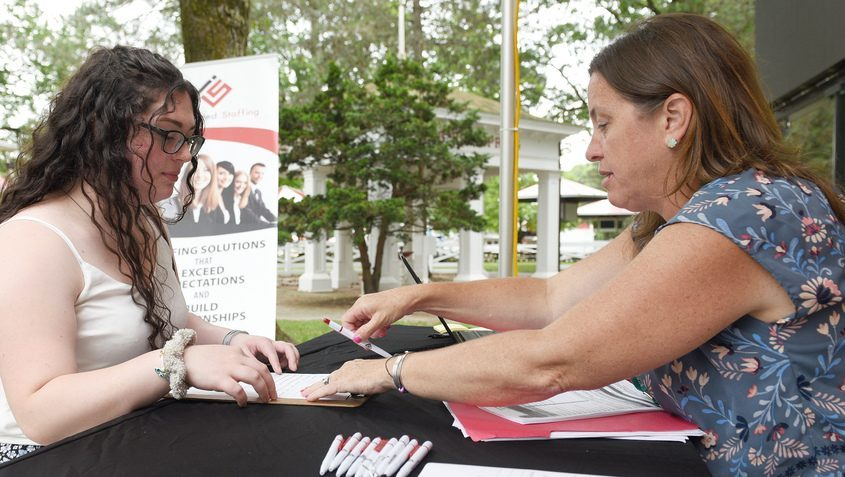 Reagan Delaney of Ballston Lake fills out a job application with Jennifer Marin at Saratoga Race Course on Wednesday, July 7, 2021.