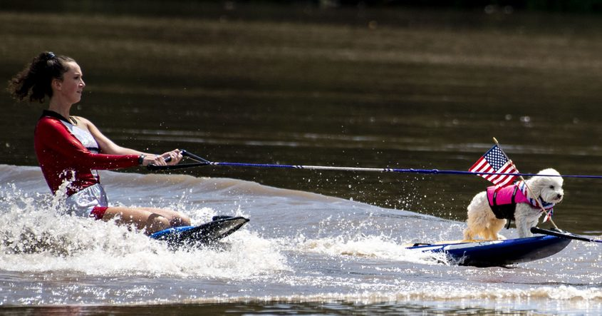Erin Pratt, left, and Mia begin the X-Squad Ski Show during the National Anthem at Riverlink Park in Amsterdam Saturday