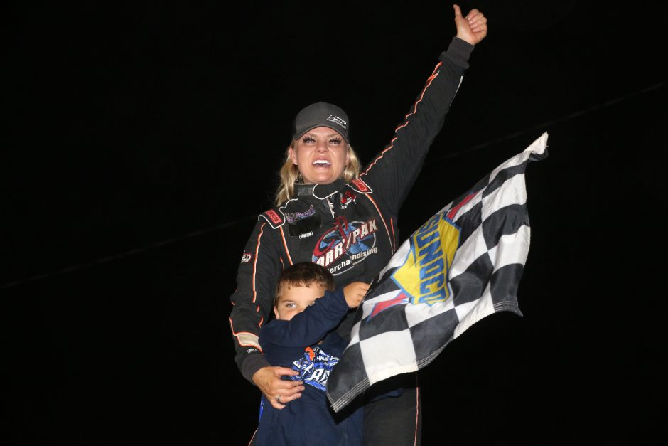Jessica Friesen celebrates with her son Parker in victory lane after winning the Sunoco Modified feature on Saturday night at Fonda Speedway. (Photo courtesy Jeff Karabin)