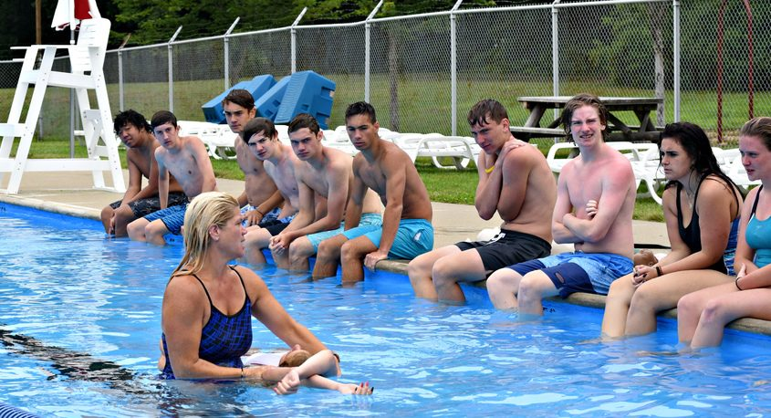 American Red Cross lifeguard instructor Julie Rouse talks to more than a dozen teenagers during the second day of lifeguard training Sunday at the Town of Niskayuna Pool.