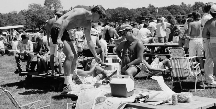 A man dressed for success  -- suntan success, anyway  -- balances beverages and bets on a Saratoga Race Course picnic table on July 24, 1991.
