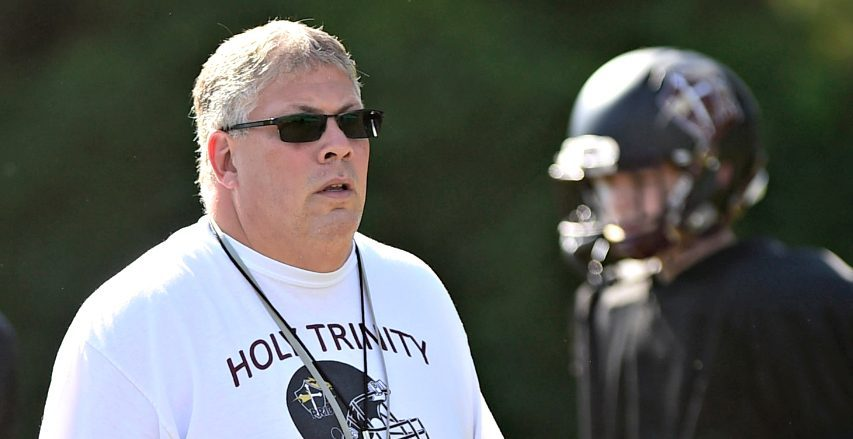 John Barber, who coached Holy Trinity football for eight seasons, is now the Troy High School football coach.