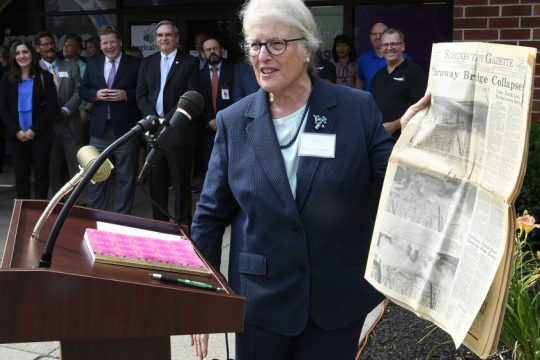 Daily Gazette Board Chairwoman Betsie Hume Lind speaks in front of The Daily Gazette building at a ceremony marking the newspaper's 125th anniversary in 2019.