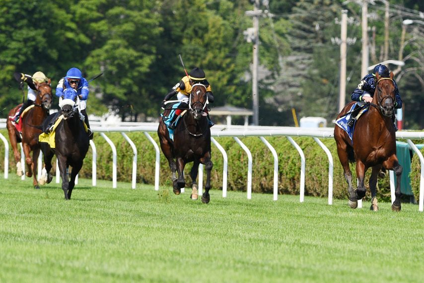 Golden Pal, right, runs away from the field in the Quick Call at Saratoga on Thursday.