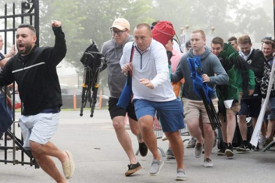 """People make the """"mad dash"""" to find the perfect picnic tables as the gates are opened on opening day at Saratoga Race Course in Saratoga Springs on Thursday."""