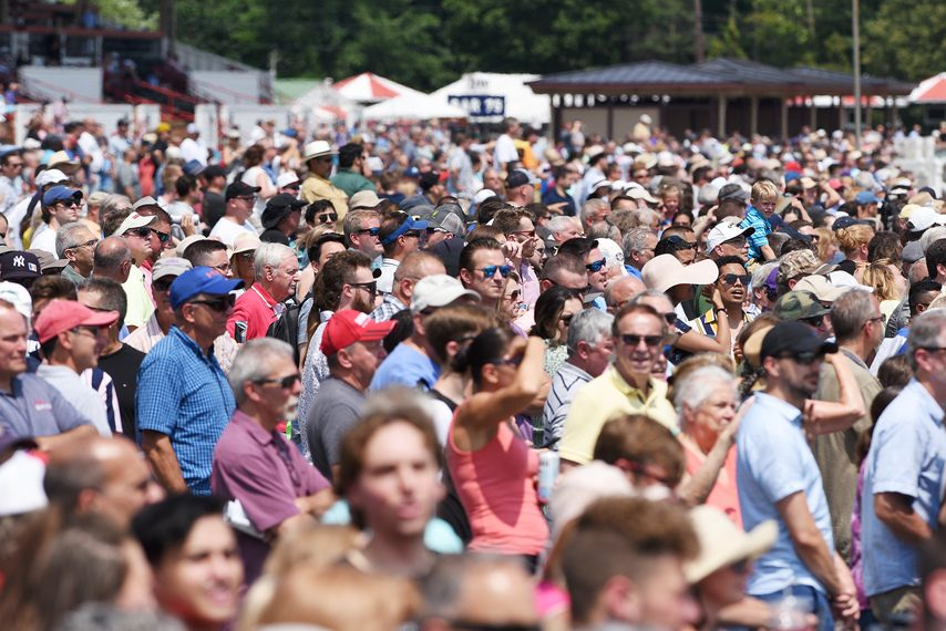 A crowd of 27,760 watches the third race at Saratoga on Thursday.