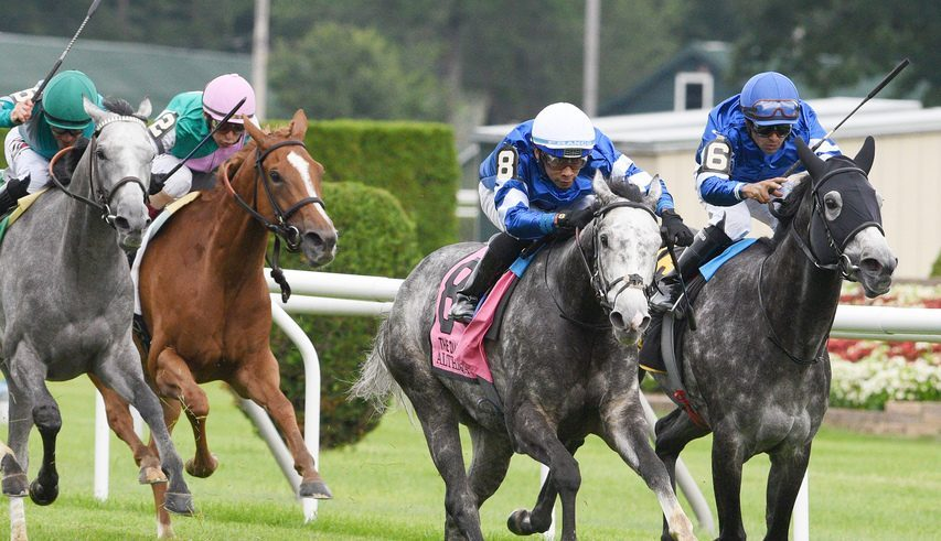 Althiqa (8) gets past her stablemate Summer Romance (6) to win the Grade I Diana at Saratoga on Saturday.
