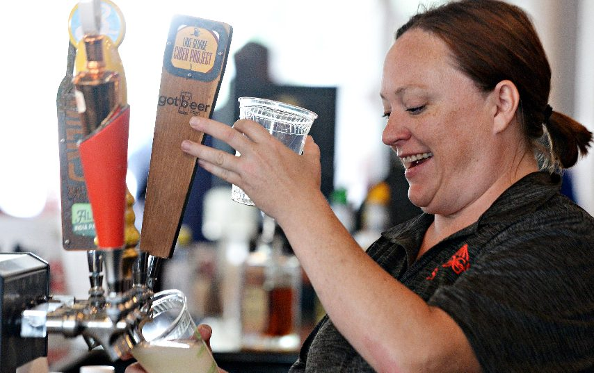 Bartender for her eighth year, Lee Spinelli, of Colonie, serves beverages to customers at FourStarDave bar at Saratoga Race Course in Saratoga Springs on Saturday, July 17, 2021. (ERICA MILLER/THE DAILY GAZETTE)
