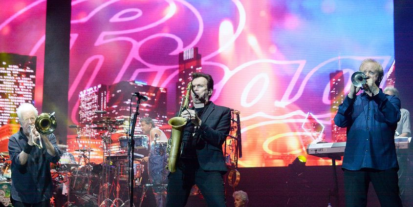 Chicago's James Pankow on trombone, Ray Herrmann on saxophone and Lee Loughnane on trumpet perform on stage at SPAC Sunday.