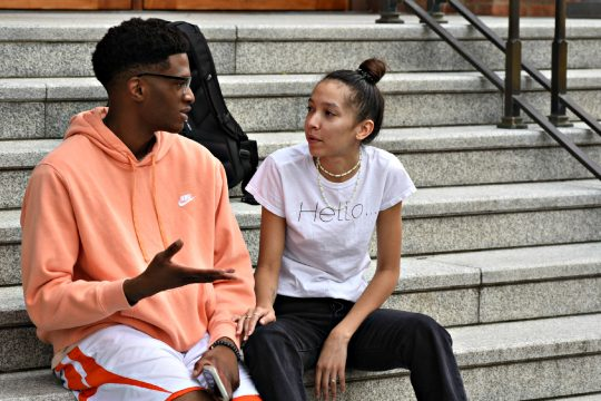 Alexus Brown talks with Marcus Filien after a press conference held on the steps of Saratoga Springs Cityon Monday.