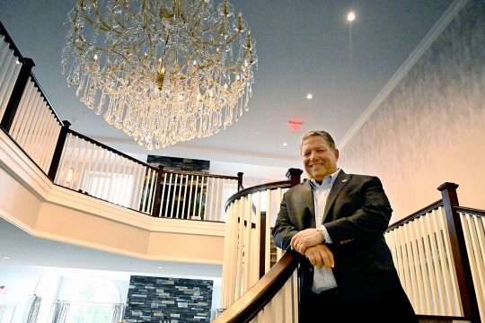 Angelo Mazzone shows off renovations to the Glen Sanders Mansion in this Gazette File Photo. The company that bought Mazzone's company is suing his son over the use of the name.