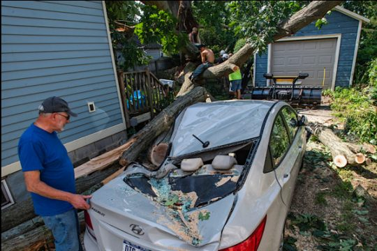 Joe Rizzo looks at his son's wife's car that was destroyed Tuesday night.