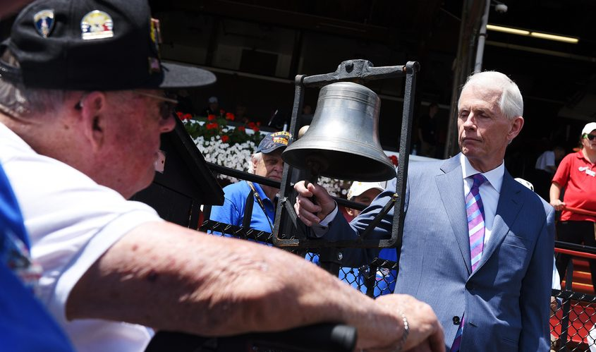 ERICA MILLER/GAZETTE PHOTOGRAPHER   Matt Jones, of Saratoga Springs, rings the bell in honor of his late father Mayor Ellsworth Jones who was among the first US paratroopers to drop into France during the early hours of D-Day invasion, in the winners circle at Saratoga Race Course on Military Appreciation Day 2019.