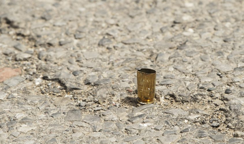 A shell casing stands on end in the middle of Becker Street after a shooting in front of Mos Food Marketin 2017.