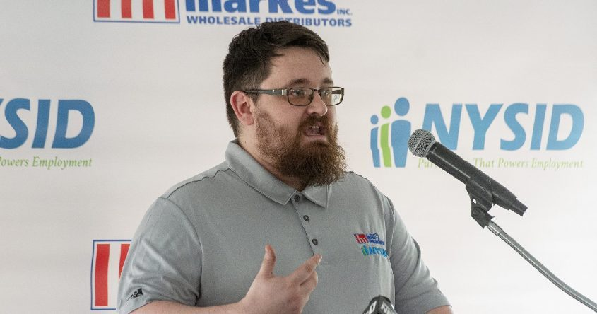 NYSID employee Ryan Bellows of Gloversville speaksat the announcement ofa new partnership between Hill & Markes Wholesale Distributors and NYSID in the town of Amsterdam on Thursday.