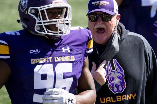UAlbany football coach Greg Gattuso has words with Jared Verse after a Rhode Islandduring a March 20 game at Tom & Mary Casey Stadium in Albany.