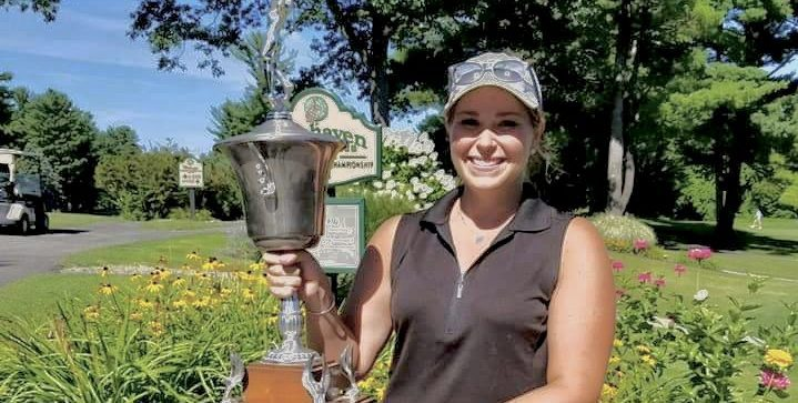 Rachel Barlette of Shaker Ridge Country Club hoists the trophy after winning her first NEWGA Championship last year at Pinehaven Country Club. (Bob Weiner photo)