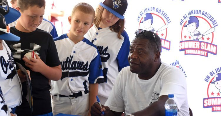 Former New York Yankee Charlie Hayes signs autographs Saturday for players who are competing in the BH-BL Junior Baseball Summer Slam Tournament at Indian Meadows Park in Glenville.
