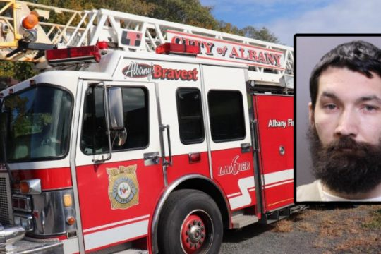 Ted L. Zarins and the fire truck taken - Credit: Colonie Police Department