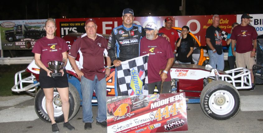 Stewart Friesen, second from right, celebrates in victory lane with the Lazzaro family after winning the Sunoco Modified feature on Saturday at Fonda Speedway. (Photo courtesy Jeff Karabin)