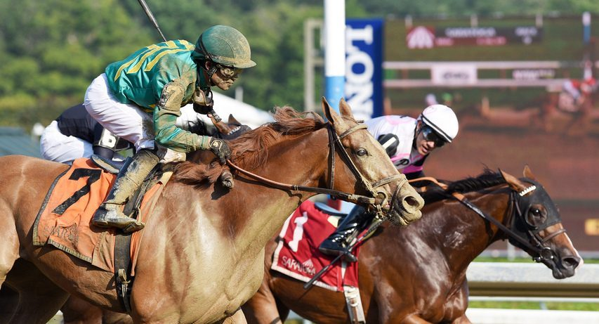 Junior Alvarado, on Horologist (1), can only watch as Royal Flag (7) and Joel Rosario pass them to win the Shuvee at Saratoga on Sunday.