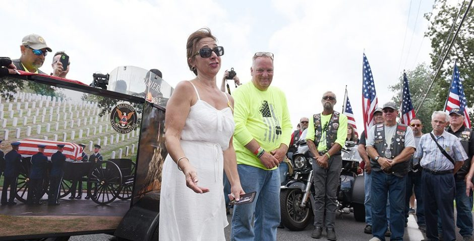 Vickie DeAugustine, mother of the late Sgt. David Fisher, speaks as they honor him during the 12th annual Tribute to Fallen Soldiers Memorial Torch Motorcycle Ride: A Run to Arlington National Cemetery on Route 9P in Saratoga Springs on Sunday.
